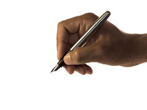 Hand holding fountain pen. A hand holding a silver fountain pen isolated on white Stock Photo