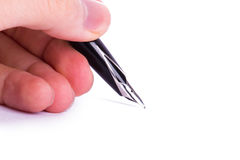 Hand Holding Fountain Pen Stock Photo