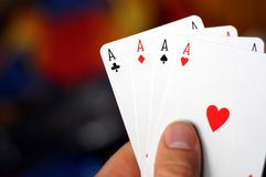Hand holding four aces Stock Images