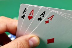 Hand holding four aces Royalty Free Stock Images