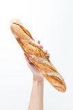 Hand holding a French baquette bread Stock Photos