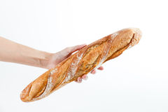 Hand holding a French baquette bread Royalty Free Stock Images