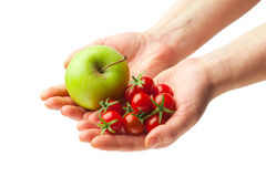 Hand holding fresh apple and tomatoes Royalty Free Stock Photography