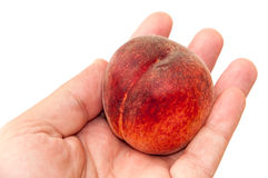 Hand holding fresh peach over white Royalty Free Stock Photography