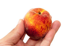 Hand holding fresh peach over white Royalty Free Stock Image