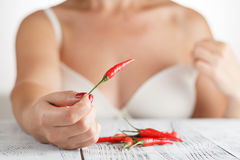 Hand holding Fresh red Chilli Royalty Free Stock Photo