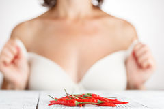 Hand holding Fresh red Chilli Stock Photos