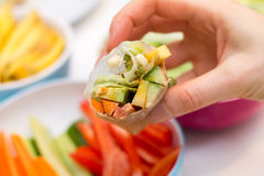 Hand holding fresh spring roll with vegetable filling Royalty Free Stock Photography