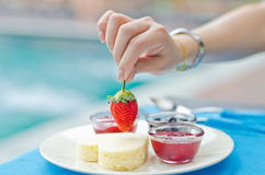 Hand holding fresh strawberry Stock Photo