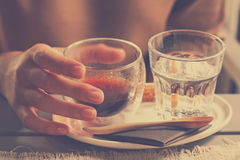 Hand holding a freshly brewed of hot black coffee americano Royalty Free Stock Photography