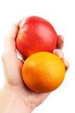 Hand holding fruit. Apple orange Royalty Free Stock Image