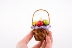 Hand holding a fruit basket Royalty Free Stock Image