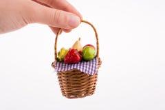 Hand holding a fruit basket Stock Image