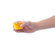 hand holding fruit cupcake Stock Photo