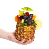 Hand holding Fruit Salad in a Pineapple Stock Photos