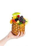 Hand holding Fruit Salad in a Pineapple Stock Images