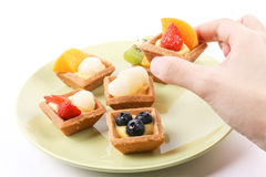 Hand holding fruit tart Stock Photography