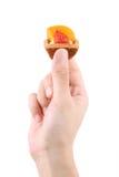 Hand holding fruit tart - series 2 Royalty Free Stock Image