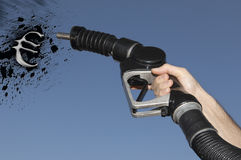 Hand holding Fuel hose spraying petrol oil in the shape of the Euro Symbol Stock Photography