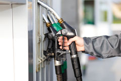 Hand holding a fuel nozzle Stock Photography