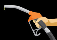 Fuel pump nozzle. Hand holding fuel nozzle on petrol gas station Stock Photography