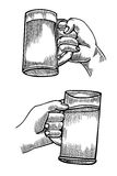 Hand holding a full glass of beer Stock Images