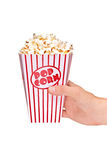 Hand holding a full popcorn box Stock Photography