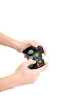 Hand holding game controller. On white stock photography