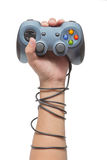 Hand holding game controller and tied up with cables Royalty Free Stock Image