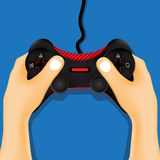 Hand holding game controller. Stock Images