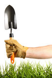 Hand holding garden trowel Royalty Free Stock Images