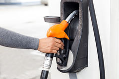 hand holding gas pump nozzle Royalty Free Stock Photos