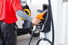 hand holding gas pump nozzle Stock Images