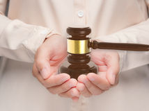 Hand holding gavel judge Royalty Free Stock Photos