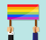 Hand holding a gay pride flag Royalty Free Stock Photos