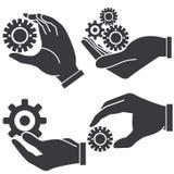 Hand holding gear Stock Photos