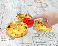 Hand holding gear to combine with currency symbol gears Stock Photo