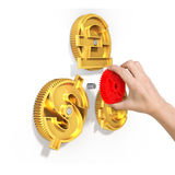 Hand holding gear to combine with currency symbol gears Royalty Free Stock Photo