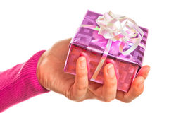 Hand holding gift Stock Photos
