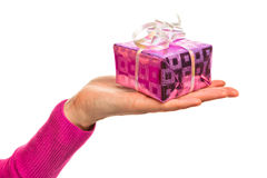 Hand holding gift Royalty Free Stock Photo