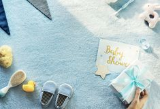Hand holding gift for baby shower. And baby things royalty free stock images