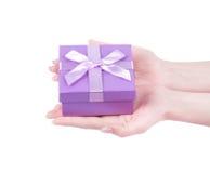 Hand holding gift box Stock Image
