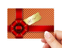 Hand holding gift card isolated over white Stock Photos