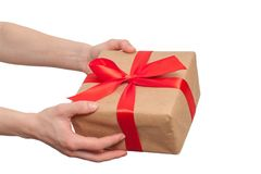 Hand holding gift with red bow isolated on white background.  Stock Photography