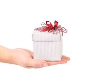 Hand holding gift in white package Royalty Free Stock Image