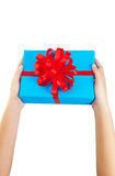 Hand holding gift wrapped Royalty Free Stock Images
