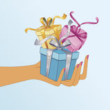 Hand holding gifts Royalty Free Stock Photos