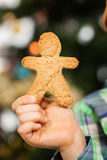 Hand holding gingerbread man Stock Image
