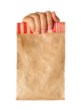 Hand holding paper bag Stock Photos