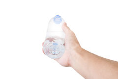 Hand holding, giving or receiving bottle of water, selective focus, isolated on white background Stock Image